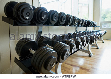 Dumbbells in a row - Stock Photo