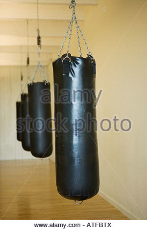 A row of punch bags - Stock Photo