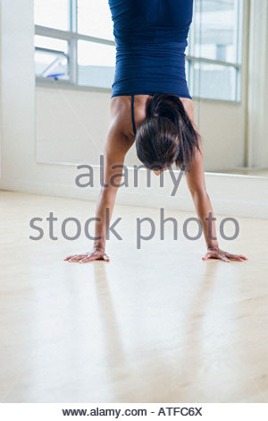 A woman doing a handstand - Stock Photo