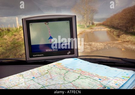 A Tom Tom Satnav device leads a vehicle up an unmade road passable by only tractors. Picture by Jim Holden. - Stock Photo