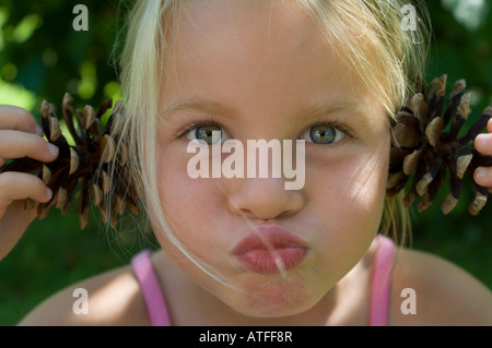 A girl pulling faces - Stock Photo