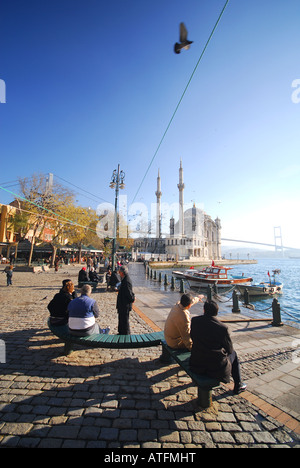 ISTANBUL, TURKEY. A winter scene on the Bosphorus waterfront at fashionable Ortakoy, with the Mecidiye Mosque behind. - Stock Photo