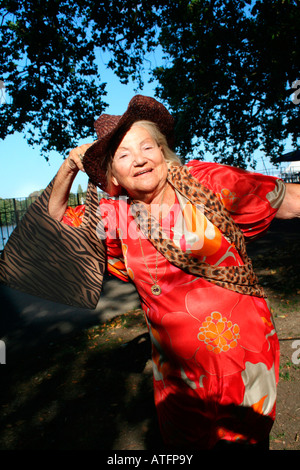 old lady having fun and full of life - Stock Photo