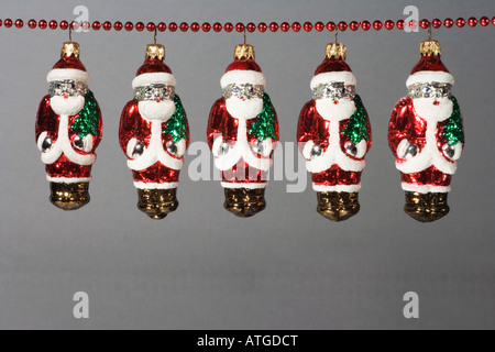 Santa claus decorations hanging in a row - Stock Photo