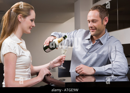 Couple drinking champagne - Stock Photo