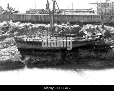 Old Fishing boat on mud flat - Stock Photo