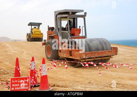 Work in progress heavy road rollers in construction new highway coast of Oman - Stock Photo
