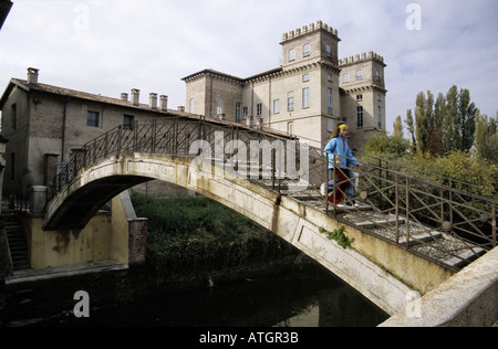 The oldest bridge on the Naviglio in the Milan province - Stock Photo