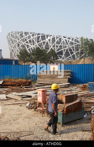 Worker On Construction Site Outside Olympic Stadium, Beijing - Stock Photo