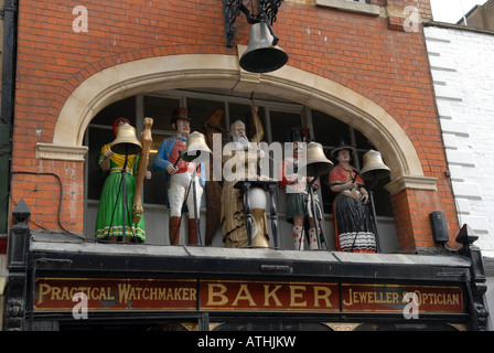 Clock and figures over Bakers jewellers in Southgate in city of Gloucester, England. - Stock Photo
