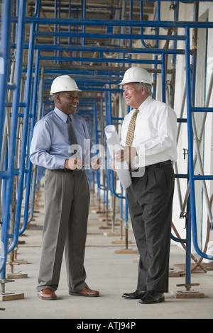 Two engineers at a construction site - Stock Photo