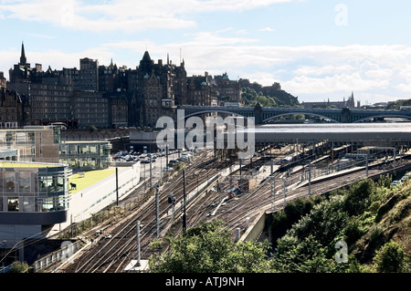 Rail tracks approach Waverley Station in front of the Old Town and Castle, Edinburgh city centre, Lothian Region, - Stock Photo
