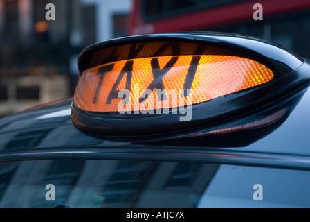 Black taxi sign, London England UK - Stock Photo