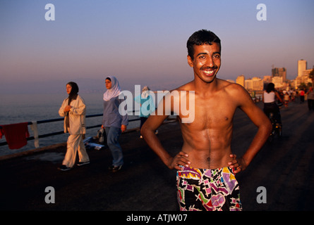 Locals pass their leisure time at the Corniche in Beirut - Stock Photo