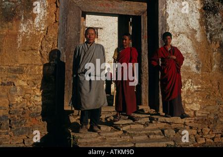 Buddhist monks at doorway of Buddhist Monastery, portrait,  Bhutan, South Asia - Stock Photo