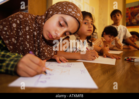 Children in drawing class at Shatila Palestinian refugee camp, Beirut, Lebanon - Stock Photo