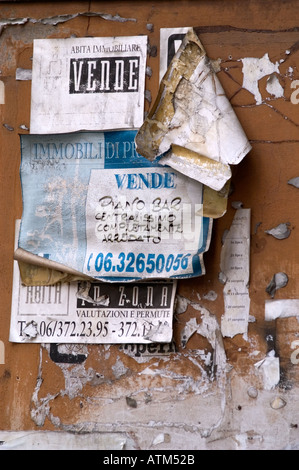 Advertising posters stuck on a wall in Rome, Italy, Europe - Stock Photo