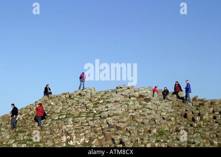 Tourtists on the Giants Causeway in Northern Ireland - Stock Photo