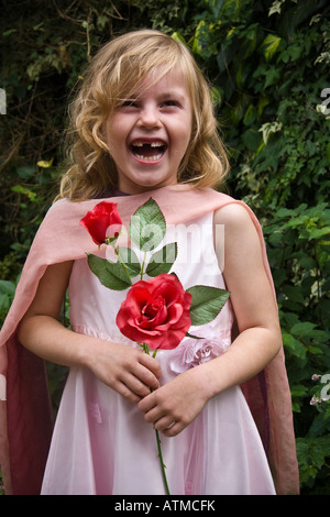 Bridesmaid with posy or red roses - Stock Photo