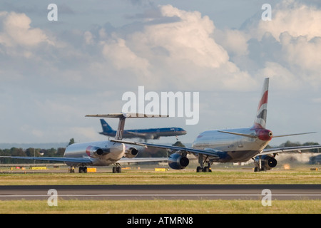Airplanes in the queue for take-off at London Heathrow Airport - Stock Photo