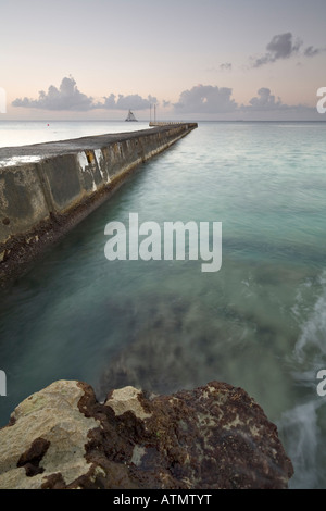Pier and rocks on Carribean Sea,  Isla de Cozumel, Mexico - Stock Photo