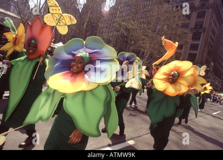 Earth Day New York City.Parade of the Planets. Environmentalists dressed as colorful flowers march up the Avenue - Stock Photo