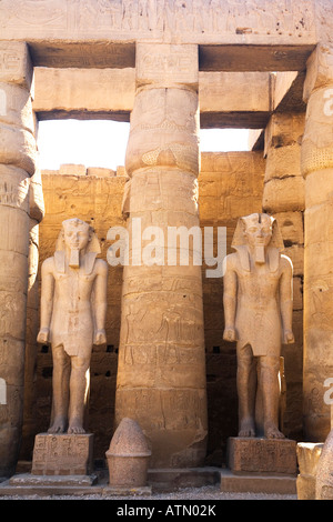 Statues of Ramses II and columns in courtyard of Luxor Temple Egypt North Africa - Stock Photo