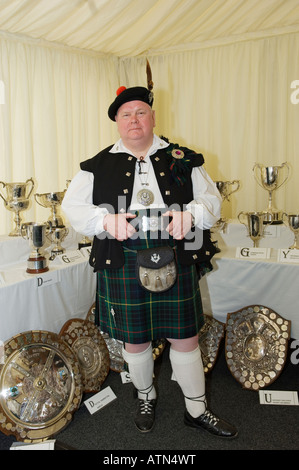 Visitor in traditional full Jacobite regalia, in the trophy pavilion at the annual Cowal Highland Gathering at Dunoon, - Stock Photo