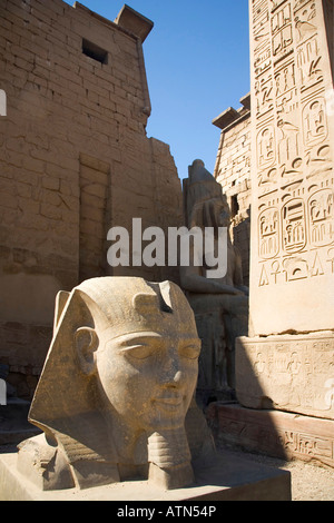 Statue of Ramses Rameses Ramesses II and pylon Luxor Temple Egypt North Africa - Stock Photo