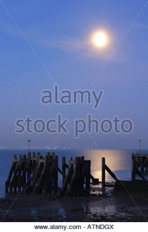 Moonlight on ruined Barge Pier on Shoebury foreshore - Stock Photo