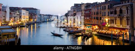 Venice, Veneto, Italy. View westwards from the Ponte di Rialto along the Grand Canal, dusk. - Stock Photo