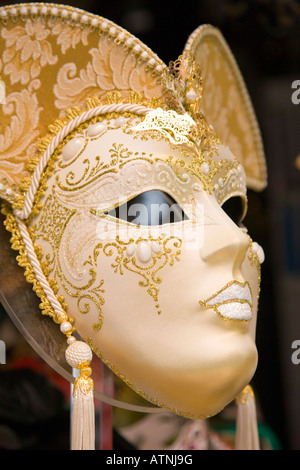 Venice, Veneto, Italy. Superbly crafted carnival mask on display in up-market shop window. - Stock Photo