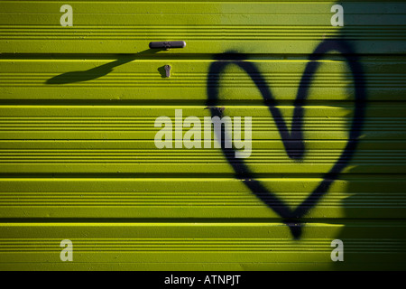 Love Heart spay painted on a green garage - Stock Photo