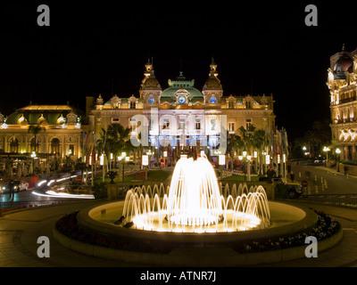 The high-rolling, famous Monte Carlo Casino at night.  Monaco. - Stock Photo