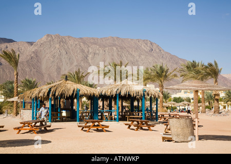 Taba Heights Sinai Peninsula Egypt Empty beach bar cafe with outdoor tables in resort on Red Sea east coast riviera - Stock Photo