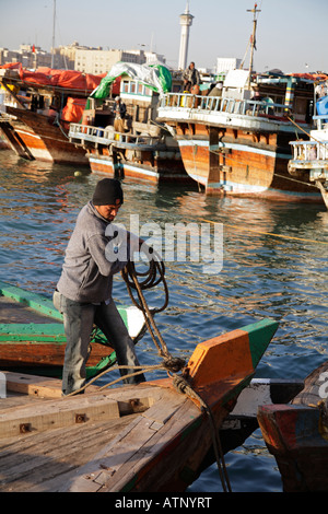 Seaman casting off- Dubai Creek 1 - Stock Photo
