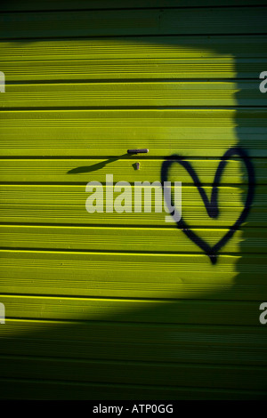 Love Heart spray painted on a green garage - Stock Photo