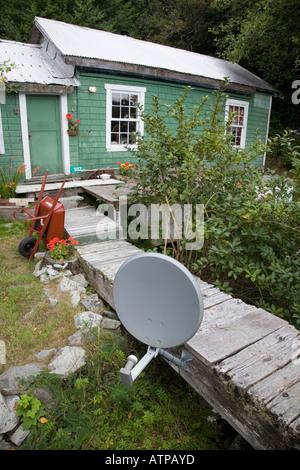 Satellite dish mounted on wooden boardwalk Bamfield Vancouver island Canada - Stock Photo