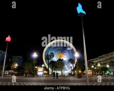 A nighttime shot of the colouful ferris wheel at Place Masséna in Nice, France. - Stock Photo