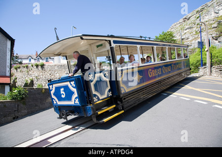People travelling on the Great Orme Tramway going downhill into Llandudno Wales UK - Stock Photo