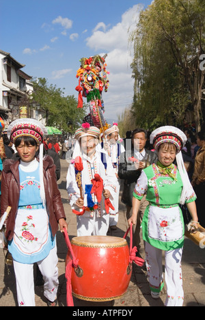Bai Ethnic Minority People Marching In Chinese New Year Parade, Dali Old Town, Yunnan Province, China - Stock Photo