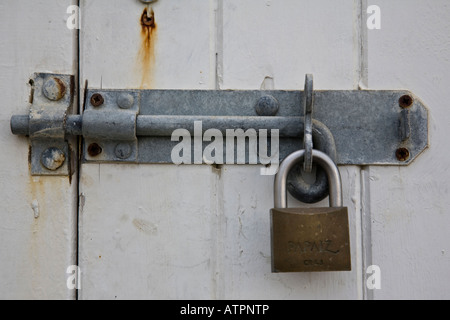 ... Close-up of padlocked door on a beach hut Worthing West Sussex & Bolt and padlock on beach hut door. Faded wood and blue paint ... Pezcame.Com