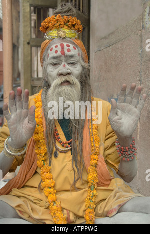 Portrait of an elderly Indian sadhu or holy man on the ghats of Varanasi, India. - Stock Photo