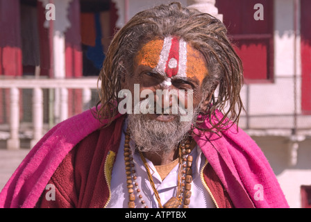 Indian Sadhu Sitting outside a temple in Udaiphur, Rajasthan - Stock Photo