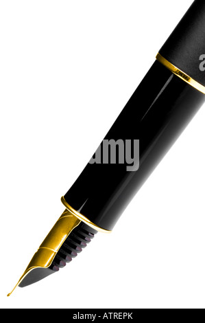 Macro shot of a fountain pen with gold nib taken at a side angle Isolated on white - Stock Photo