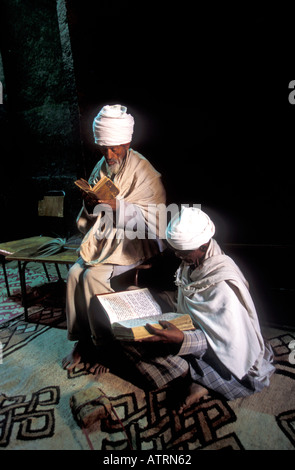 Orthodox pilgrims praying in Lalibela churches. - Stock Photo