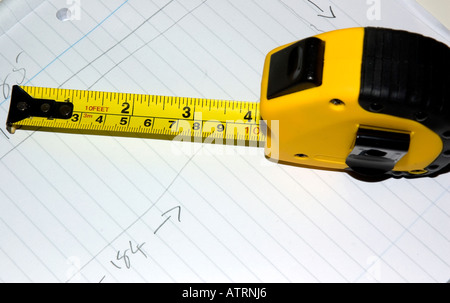 Yellow metal tape measure - Stock Photo