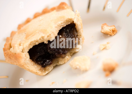 ... Half eaten mince pie on plate - Stock Photo & Half eaten mince pie on white plate with two 2 full pies ...
