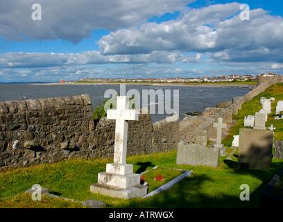 Graveyard of St Peter's Church, Heysham, looking towards the resort of Morecambe, Lancashire UK - Stock Photo