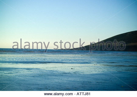 Cottage on a hillside overlooking the sea - Stock Photo
